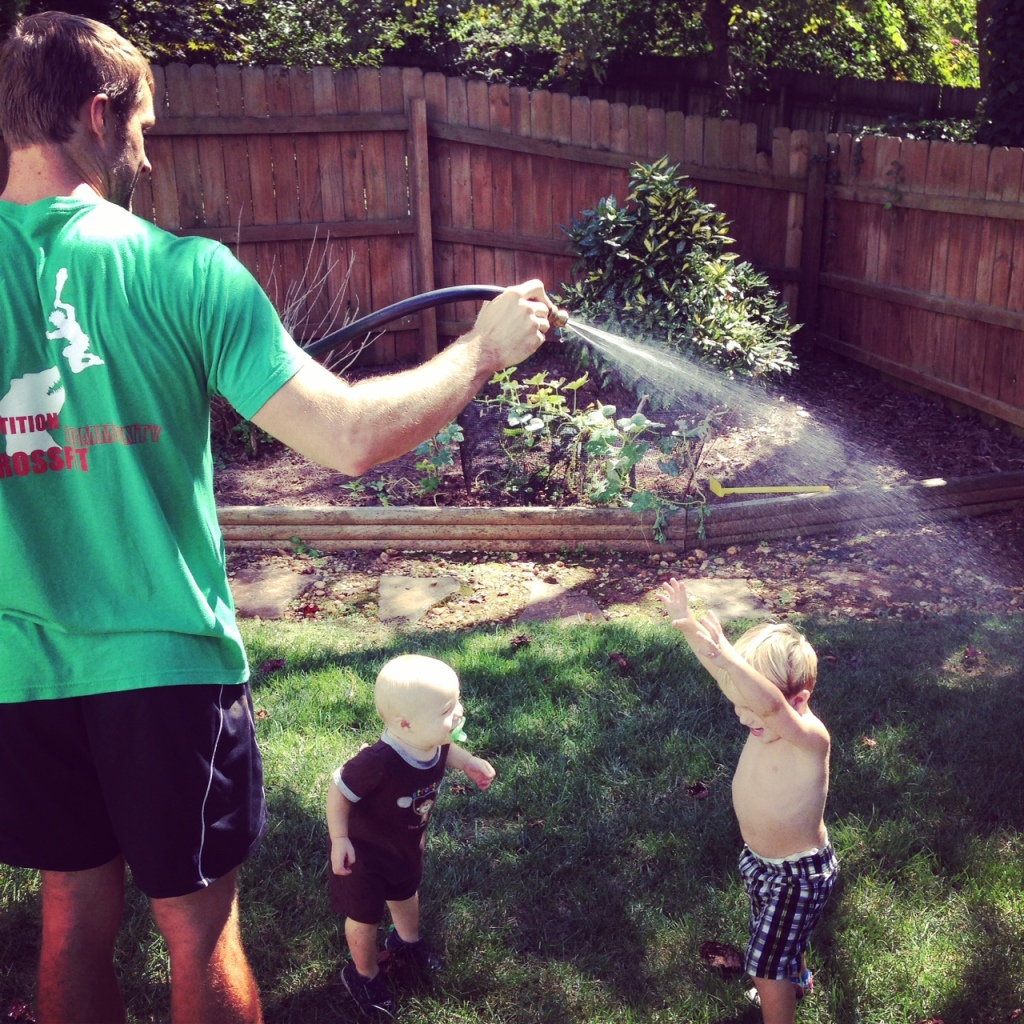 three boys water hose